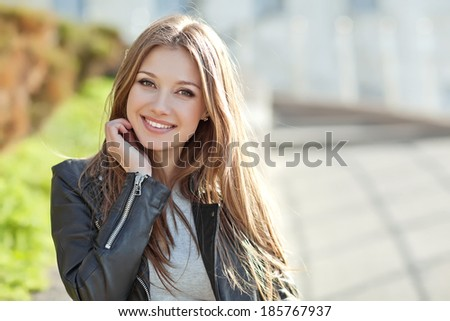 Portrait Of Young Smiling Beautiful Woman #185767937