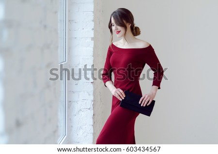 Portrait of young smiling beautiful woman in dress  #603434567