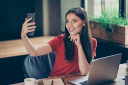 Portrait of young smiling student girl make video call from smartphone to her best friend, having break, telling good news, sitting in cafe