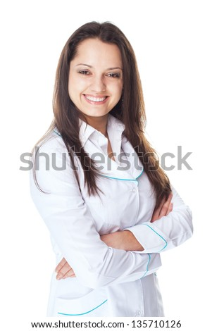 Portrait of young smiling woman doctor with arms crossed isolated on white background