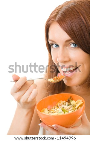 Portrait of young smiling woman eating muslin, isolated