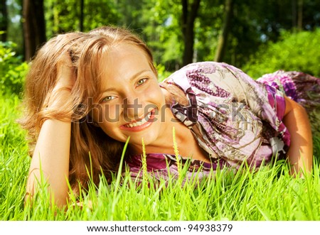 portrait of young smiling woman on the grass
