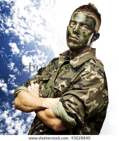 portrait of young soldier against a cloudy sky background