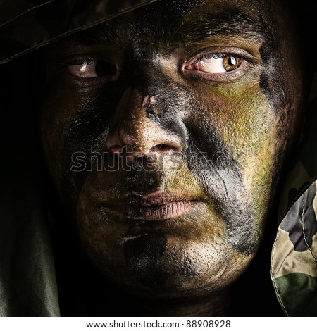 portrait of young soldier face with hood
