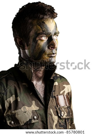 portrait of young soldier face with jungle camouflage against a white background