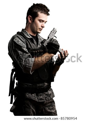 portrait of young soldier reloading his gun against a white background