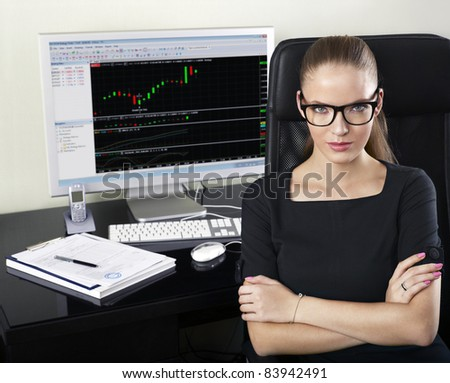 portrait of young specialist at her work place