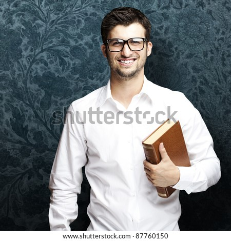 portrait of young student holding books against a vintage background