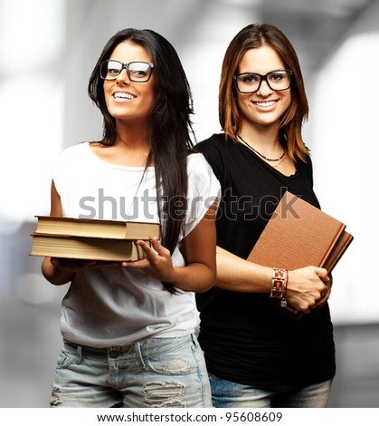 portrait of young students holding books indoor