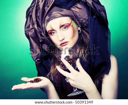 Portrait of young stylish woman with cafe seeds