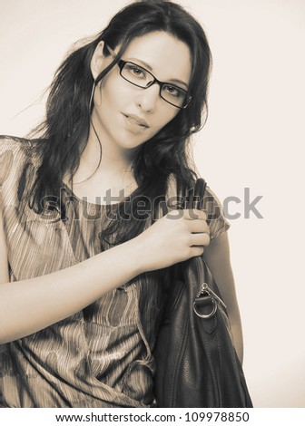 Portrait of young stylish woman with glasses