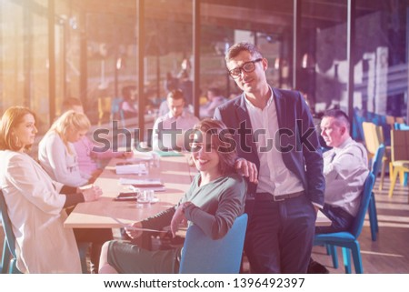 portrait of young Successful Business couple Entrepreneur At Busy startup Office #1396492397