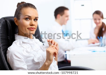 Portrait of young successful businesswoman in the office - stock photo