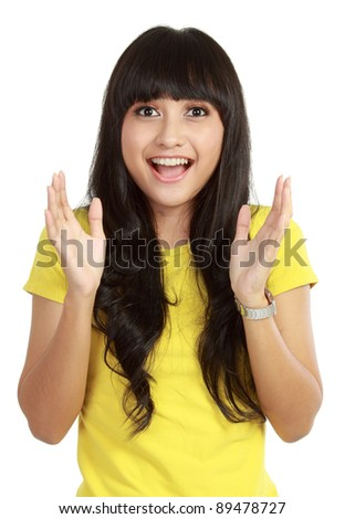 Portrait of young surprised girl isolated over white background