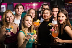 Portrait of young Teenagers celebrating end of session in the bar at evening