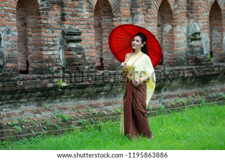 133ac07b1 Portrait of Young Thai beautiful woman in traditional Thai dress/costume is  walking in the