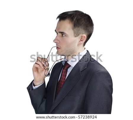 portrait of young thoughtful businessman in glasses