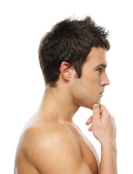 Portrait of young thoughtful man against white background.
