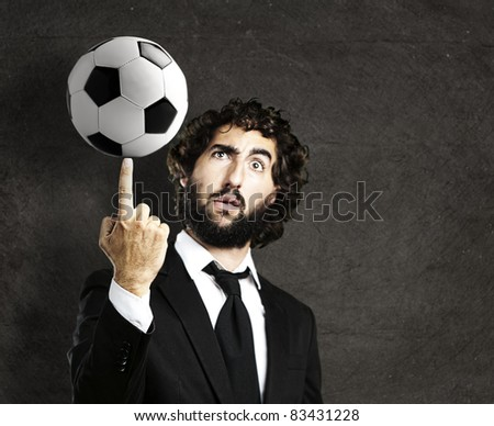 portrait of young trainer playing with a soccer ball