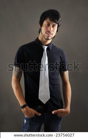 stock photo : Portrait of young trendy business man with tattoo
