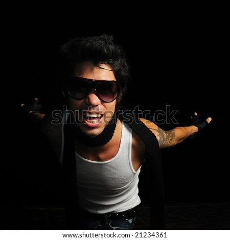 Portrait of young trendy fashion male model screaming
