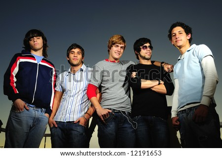 Portrait of young trendy teenager group of friends standing together
