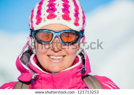Portrait of young woman a ski outfit at winter outdoor in the Zillertal Arena, Austria