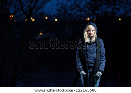 Portrait of young woman at forest