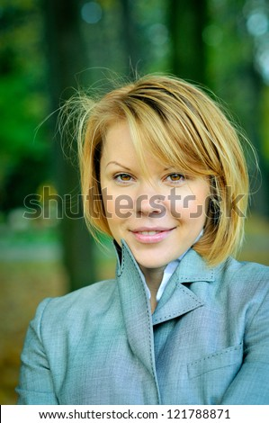 Portrait of young woman, business style