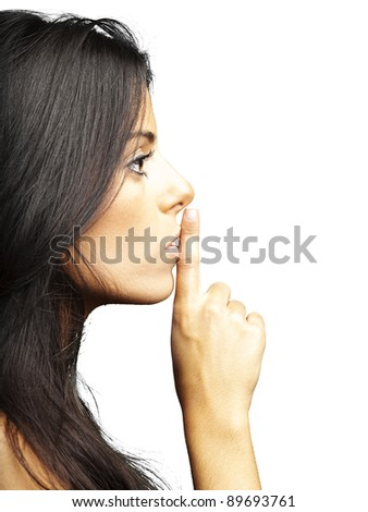 portrait of young woman doing silence sign against a white background - stock photo