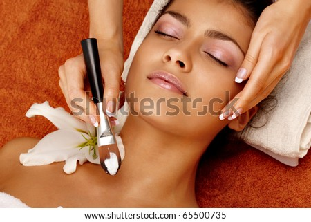 Portrait of young woman getting a spa treatment