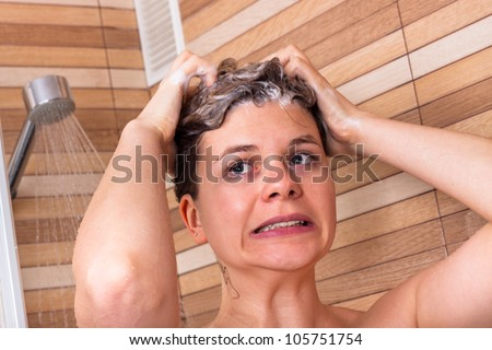 Portrait of young woman having cold shower