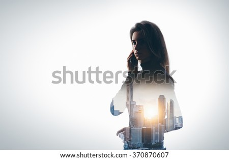 Portrait of young woman holding her smartphone in a hands. Horizontal, isolated.