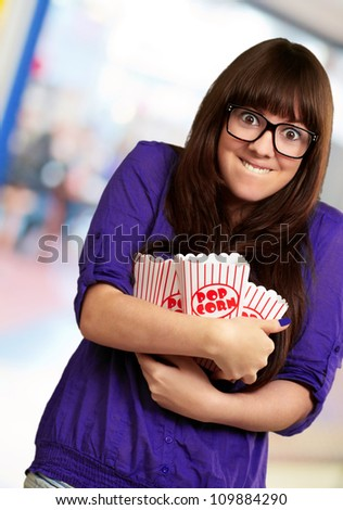 Portrait Of Young Woman Holding Popcorn Container, Background