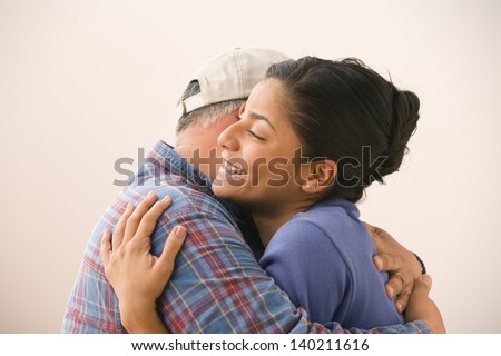 Portrait of young woman hugging her father