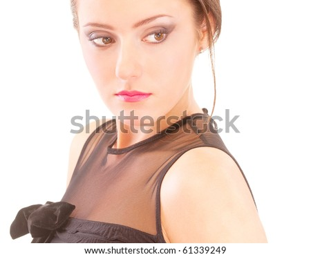 Portrait of young woman in black dress, isolated on white background.