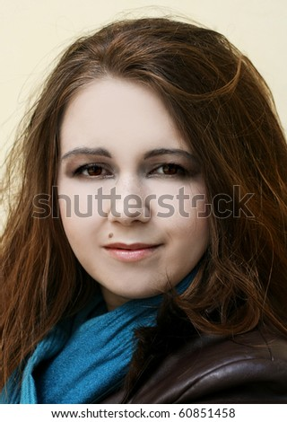 Portrait of young woman in blue scarf