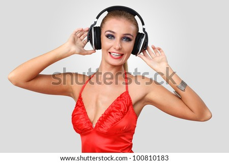 Portrait of young woman in evening dress with headphones