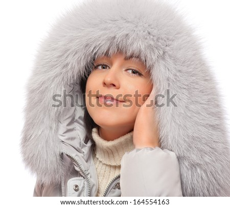 Portrait of young woman in fluffy hood #164554163