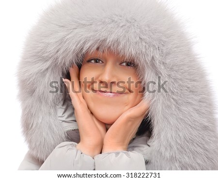 Portrait of young woman in fluffy hood #318222731