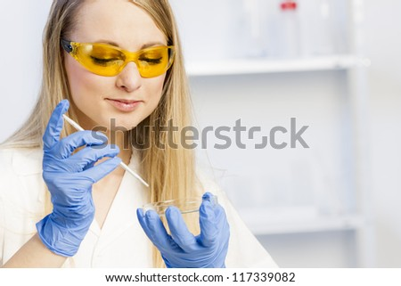 portrait of young woman in laboratory