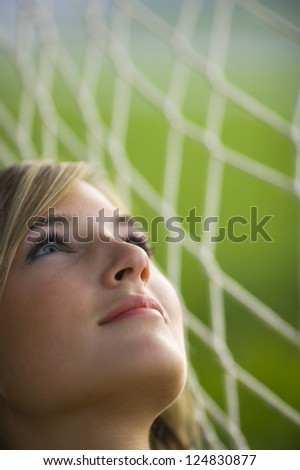 Portrait of young woman lying in hammock outdoors