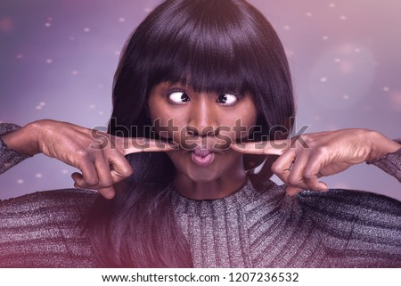 Portrait of Young Woman Making a Funny Face