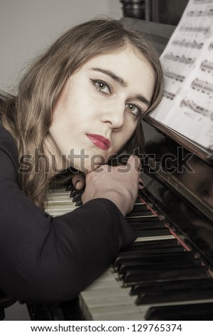 Portrait of young woman pianist close up