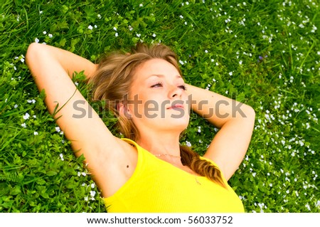 portrait of young woman resting on the meadow