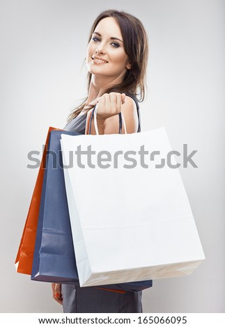 Portrait of young woman shopping bag Isolated studio background Female model