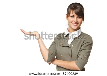 Portrait of young woman showing a product - empty copy space on the open hand palms, over white background