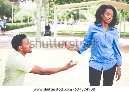 Portrait of young woman showing talk to hand gesture to desperate man hoping to persuade her to see his point. Please take me back. Isolated outdoors outside background Stock photo ©