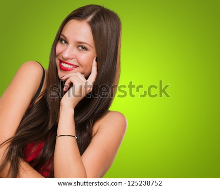 Portrait Of Young Woman Smiling against a green background