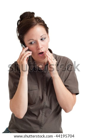 Portrait of young woman telling secret by the cell phone. Isolated over white background.